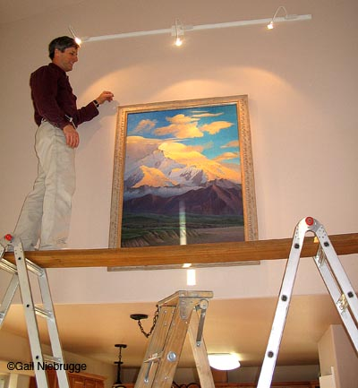 Hang Large Paintings With Ladders And Scaffold